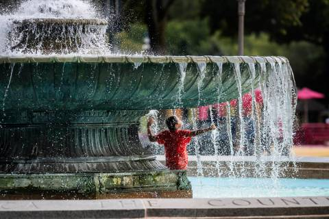 Alex Paladino cools off at the Eakins Oval fountain in Philadelphia on Sunday, July 21, 2019. ( ...