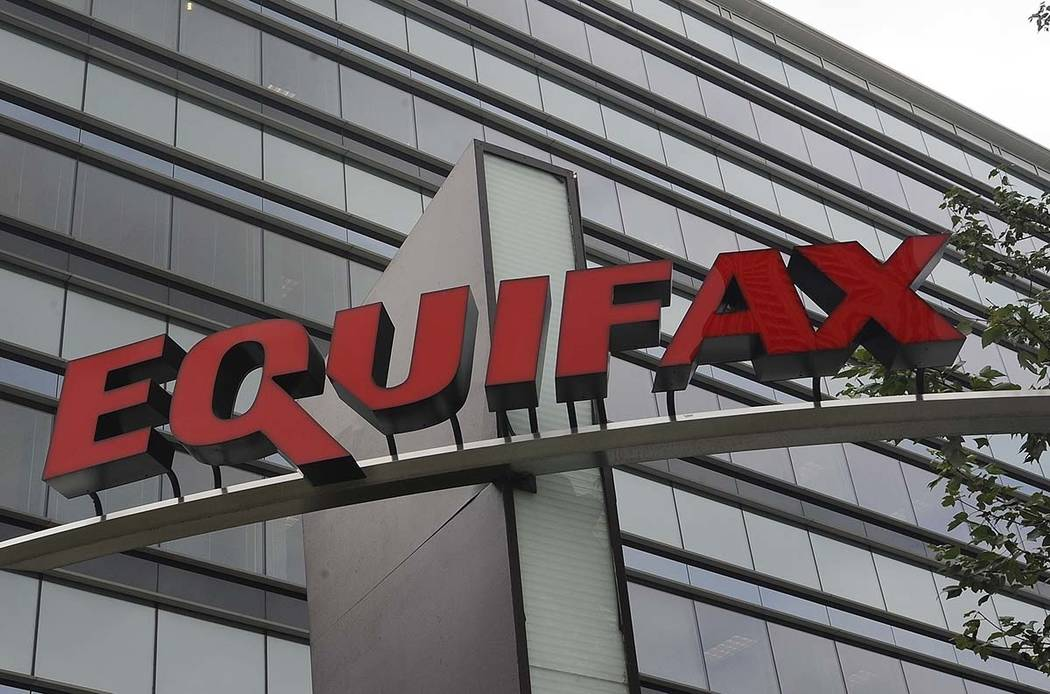 A July 21, 2012, file photo shows signage at the corporate headquarters of Equifax Inc., in Atl ...
