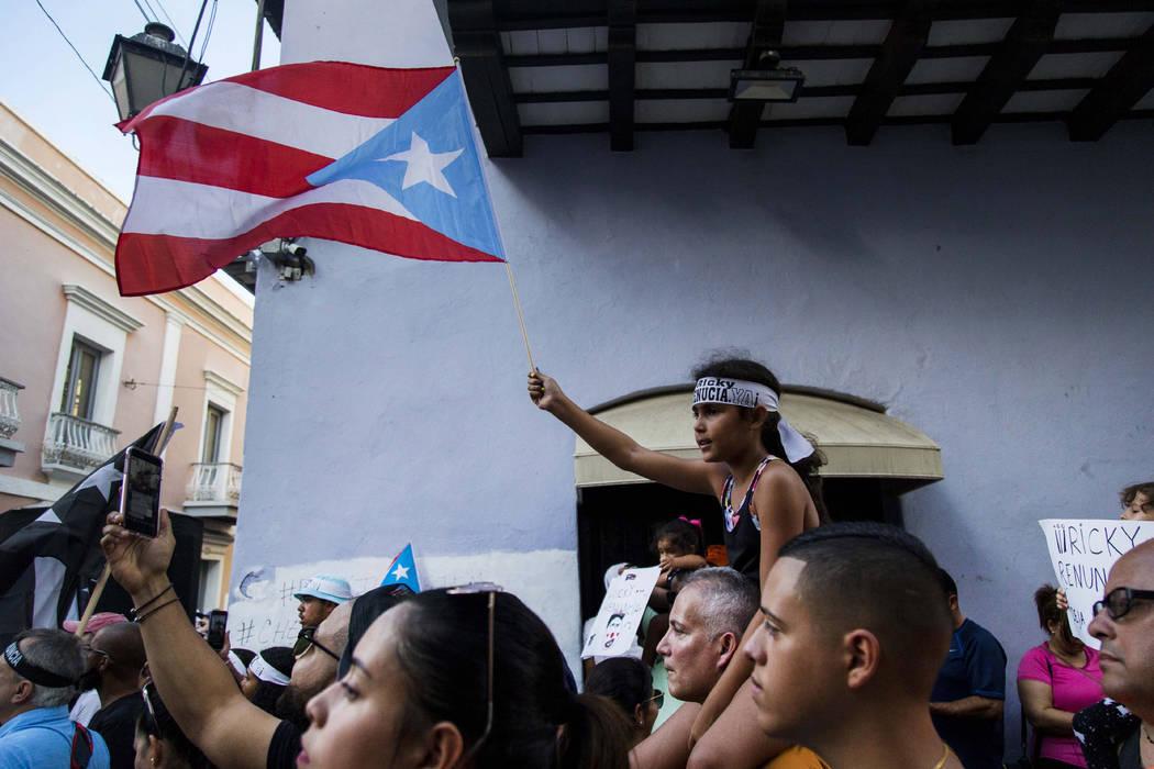 Demonstrators protest against Gov. Ricardo Rossello in San Juan, Puerto Rico, Sunday, July 21, ...