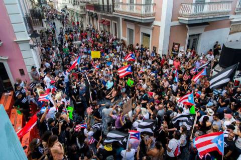 Demonstrators protest against Gov. Ricardo Rossello in San Juan, Puerto Rico, Sunday, July 21, ...
