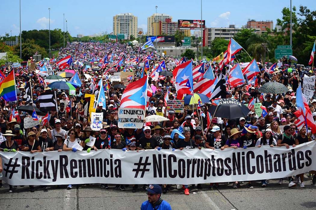 Thousands of Puerto Ricans gather for what many are expecting to be one of the biggest protests ...