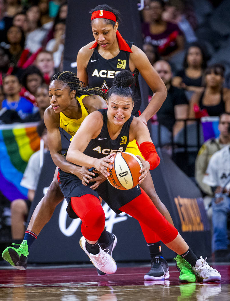 Las Vegas Aces guard Kayla McBride (21) is fouled from behind on a fast break attempt by Indian ...