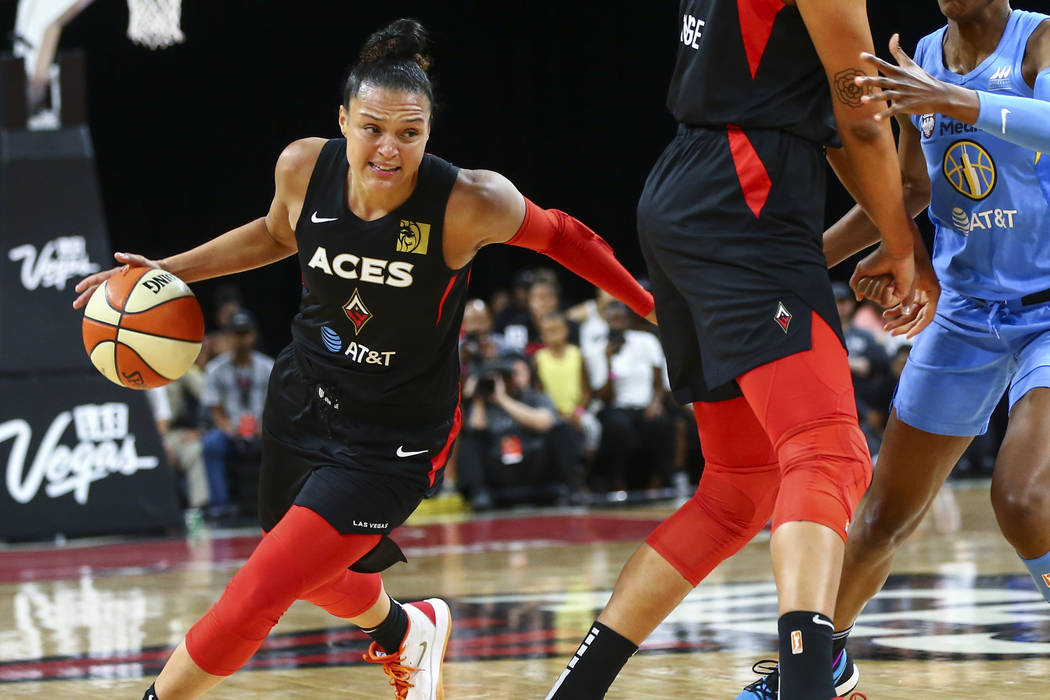 Las Vegas Aces' Kayla McBride (21) moves the ball against Chicago Sky during the first half of ...