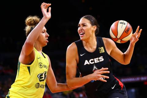 Las Vegas Aces' Liz Cambage moves the ball against Seattle Storm's Mercedes Russell during the ...