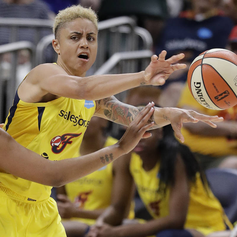 Indiana Fever's Candice Dupree (4) passes against Minnesota Lynx's Damiris Dantas (92) during t ...