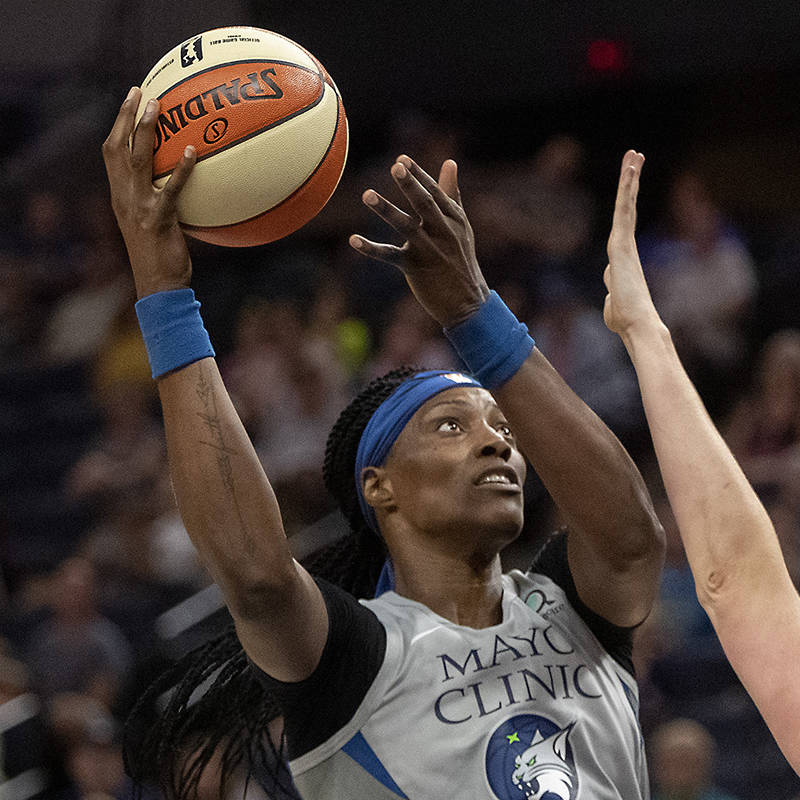 Minnesota Lynx Sylvia Fowles goes to the basket while being defended against by the Washington ...