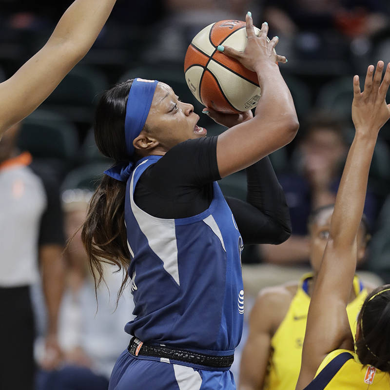 Minnesota Lynx's Odyssey Sims (1) shoots over Indiana Fever's Kelsey Mitchell (0) during the fi ...