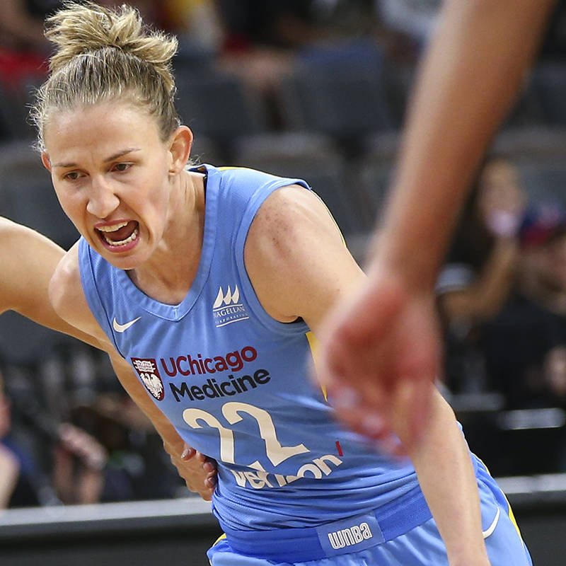 Chicago Sky guard Courtney Vandersloot (22) drives the ball past Las Vegas Aces guard Kelsey Pl ...