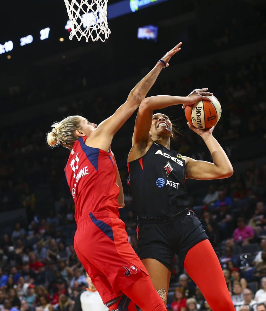In this June 20, 2019, file photo, Las Vegas Aces center A'ja Wilson, right, goes to the basket ...