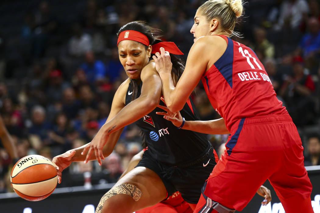 Las Vegas Aces center A'ja Wilson (22) moves the ball around Washington Mystics forward Elena D ...