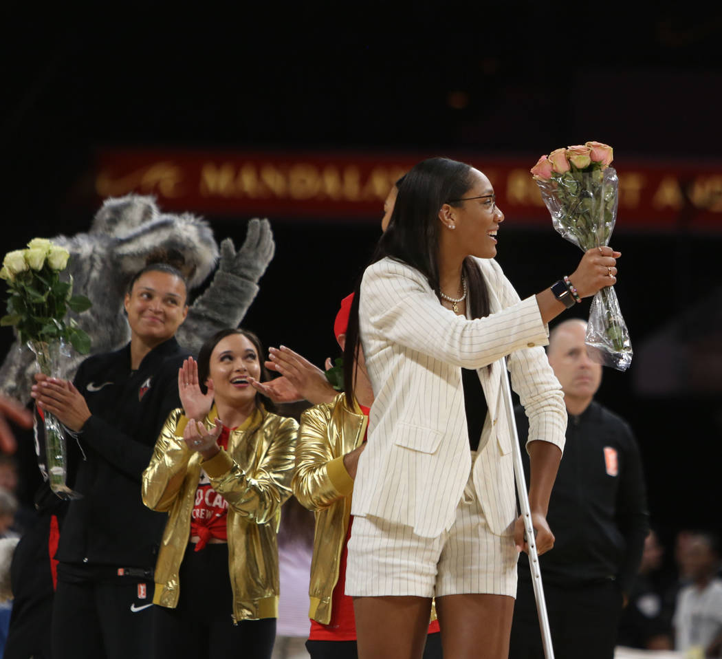 Las Vegas Aces forward A'ja Wilson (22) gets cheered on as she receives flowers for making the ...