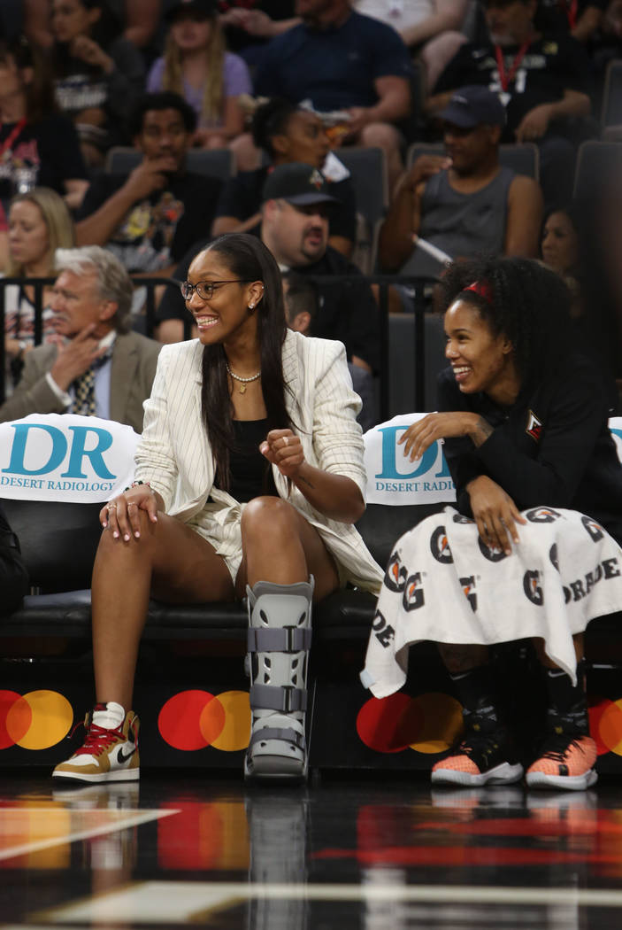 Las Vegas Aces forward A'ja Wilson, left, cheers on her team with fellow Aces forward Tamera Yo ...