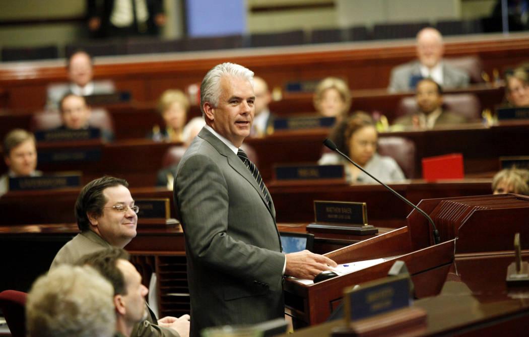 U.S. Sen. John Ensign, R-Nev., addresses the Nevada Legislature at the State Legislative Buildi ...
