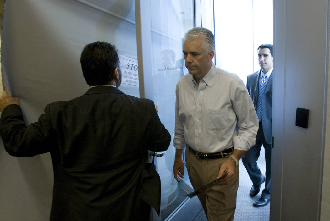 Sen. John Ensign, R-Nev., enters through a side door at the Lloyd George U.S. Courthouse in Las ...