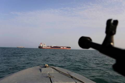 In this Sunday, July 21, 2019 photo, a speedboat of Iran's Revolutionary Guard trains a weapon ...