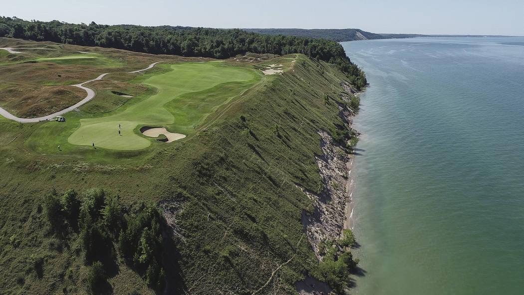 A Friday, July 13, 2019 aerial photo of Arcadia Bluffs Golf Club 12th hole green and fairway ne ...