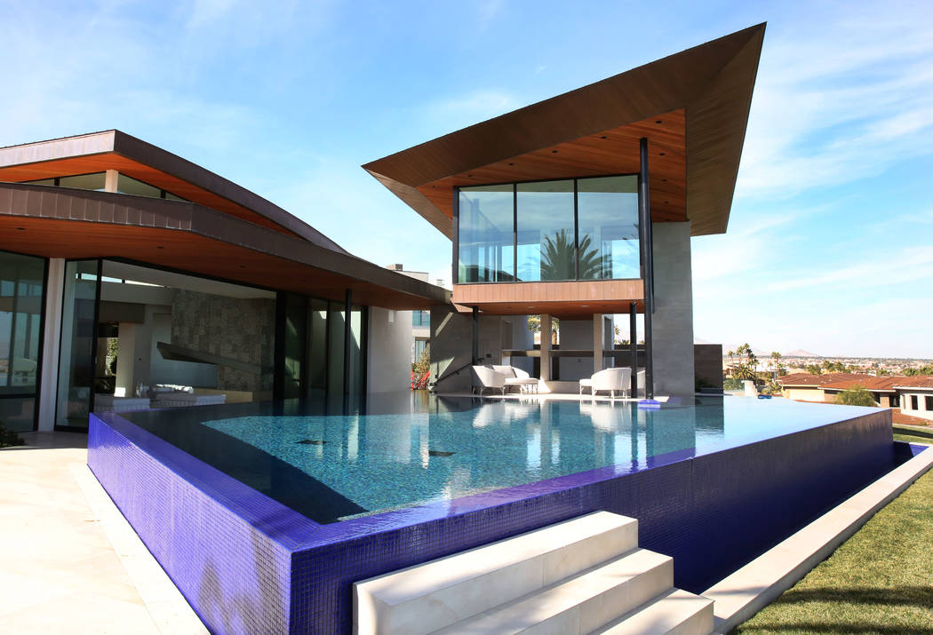 A swimming pool with Zen room, right top, and the master bedroom, left, are seen at the home of ...