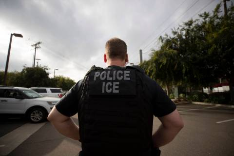 In a July 8, 2019, file photo, a U.S. Immigration and Customs Enforcement (ICE) officer looks o ...