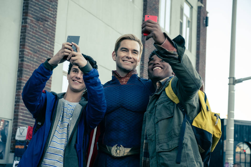 "Homelander (Antony Starr) poses for selfies in Amazon Prime's ""The Boys."""