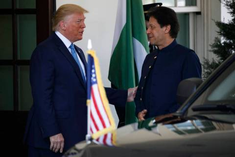 President Donald Trump greets Pakistan's Prime Minister Imran Khan as he arrives at the White H ...
