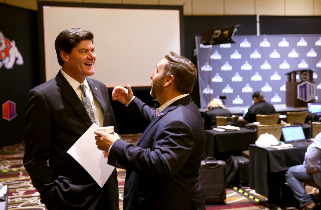 Mountain West commissioner Craig Thompson visits with Las Vegas Bowl Executive Director John Sa ...