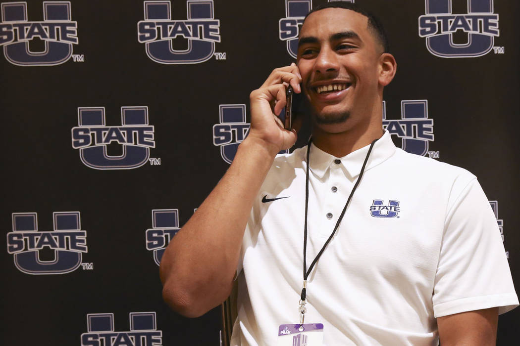Utah State quarterback Jordan Love does a phone interview during Mountain West football media d ...