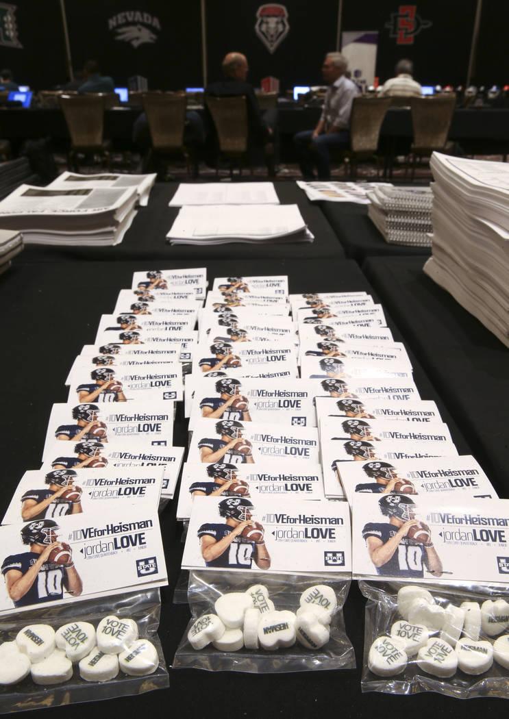 Candy promoting Utah State quarterback Jordan Love as a Heisman Trophy candidate sits among pre ...