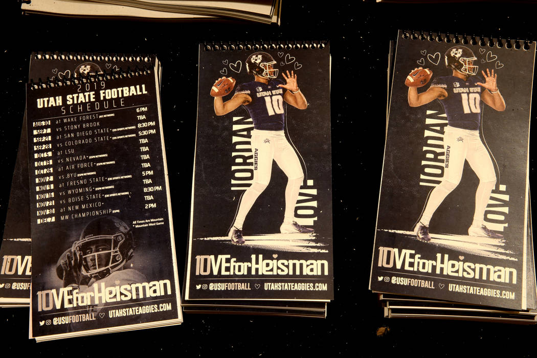 Notebooks promoting Utah State quarterback Jordan Love as a Heisman Trophy candidate sits among ...