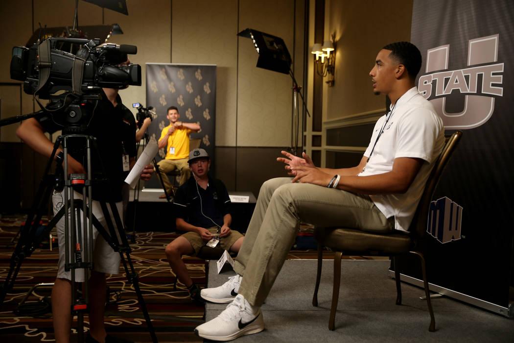 Utah State quarterback Jordan Love talks to reporters during Mountain West football media days ...