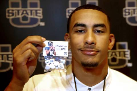 Utah State quarterback Jordan Love holds promotional candy during Mountain West football media ...