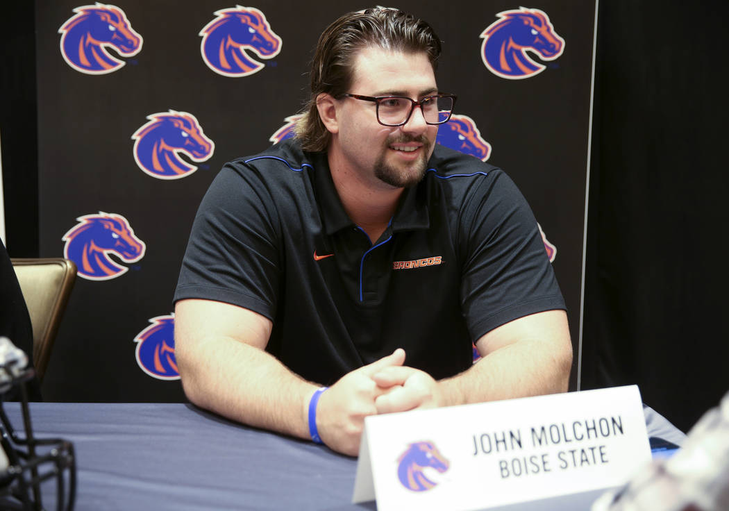 Boise State offensive lineman John Molchon talks to reporters during Mountain West football med ...