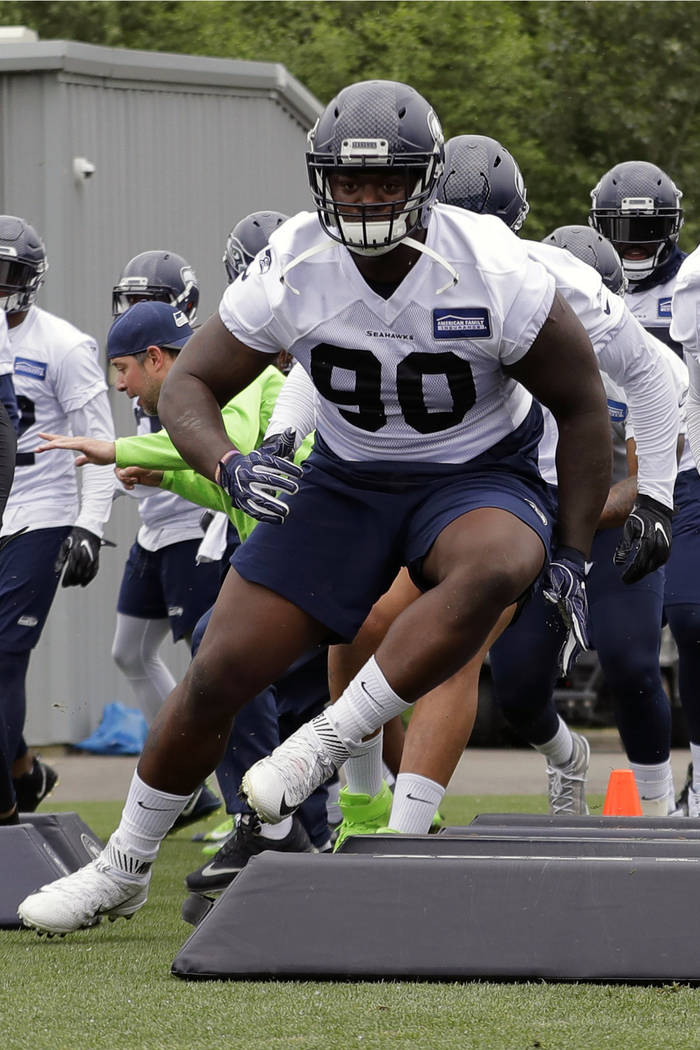 FILE - In this May 24, 2018, file photo, from left, Seattle Seahawks defensive tackle Jarran Re ...