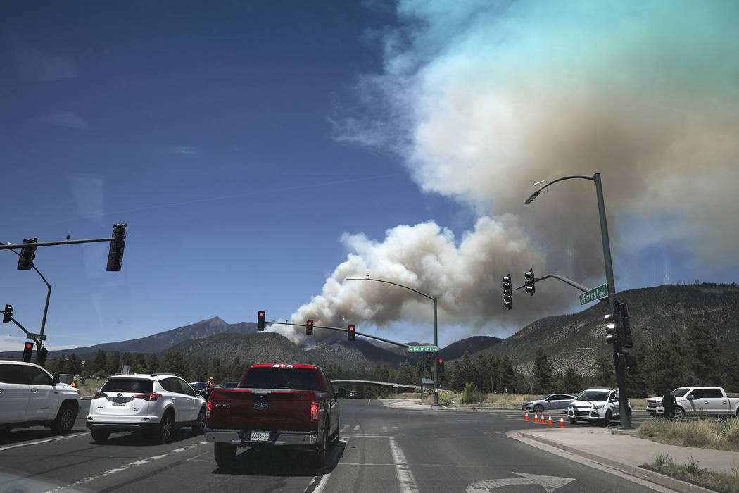 The Museum fire burns Sunday, July 21, 2019, as seen from the top of Switzer Mesa in Flagstaff, ...