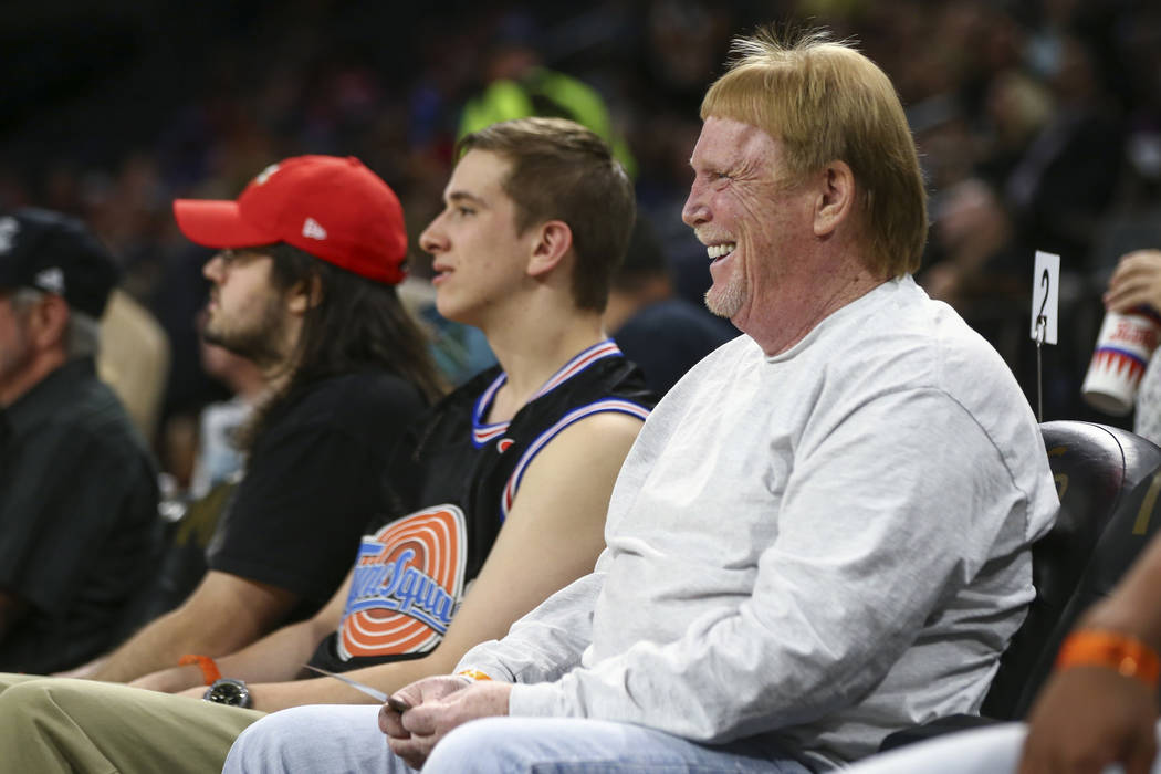 Oakland Raiders owner Mark Davis reacts while attending during the first half of a WNBA basketb ...