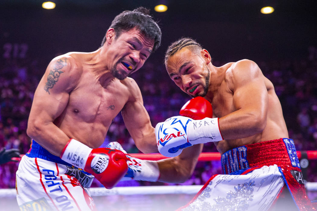 Manny Pacquiao punches Keith Thurman during Round 1 of their WBA super welterweight world champ ...