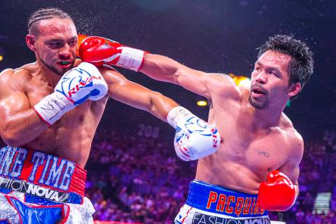 Keith Thurman is punched in the face by Manny Pacquiao during Round 5 of their WBA super welter ...