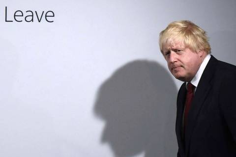 In a Friday, June 24, 2016, file photo, Vote Leave campaigner Boris Johnson arrives for a press ...