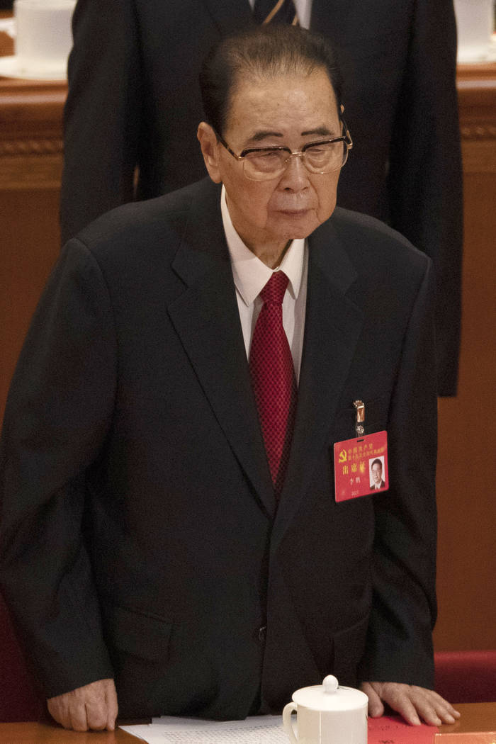 In this Oct. 24, 2017, photo, former Chinese Premier Li Peng, stands during the closing session ...