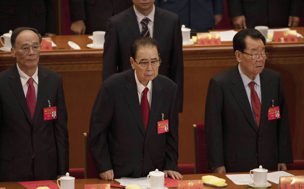 In this Oct. 24, 2017, photo, former Chinese Premier Li Peng, center, attends the closing sessi ...