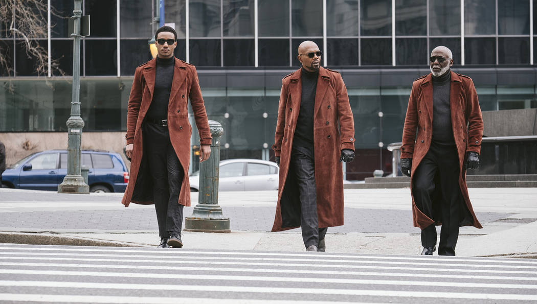This image released by Warner Bros. Pictures shows from left, Jessie Usher, Samuel Jackson and ...