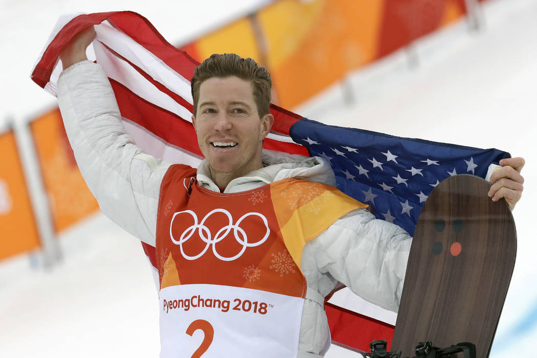 Gold medal winner Shaun White celebrates after the men's halfpipe finals at the 2018 Winter Oly ...