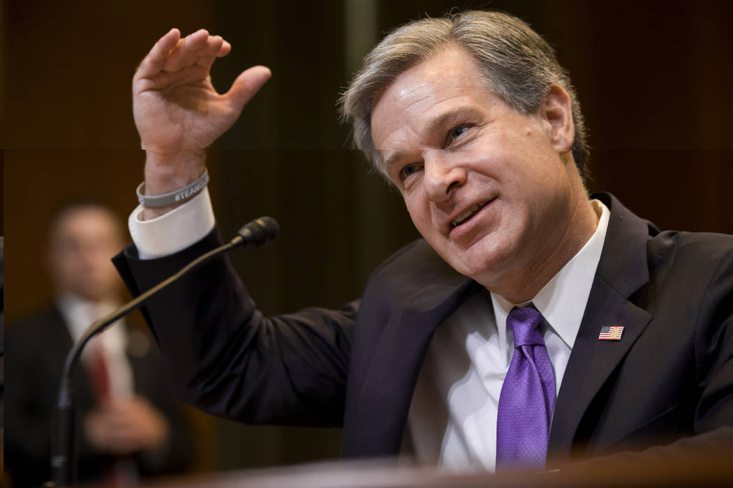 FILE - In this May 7, 2019, file photo, FBI Director Christopher Wray testifies during a hearin ...