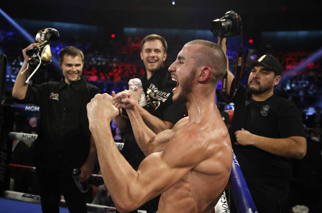 Maxim Dadashev celebrates after defeating Antonio DeMarco during a junior welterweight bout in ...