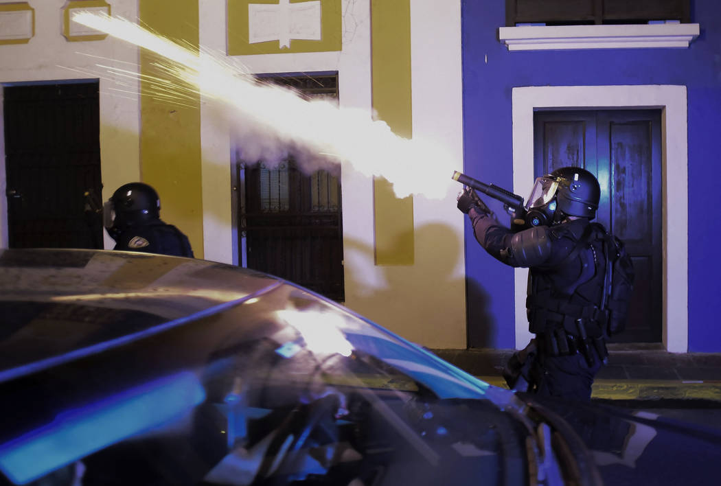 Police units launch tear gas to control several riots near the executive mansion while demonstr ...