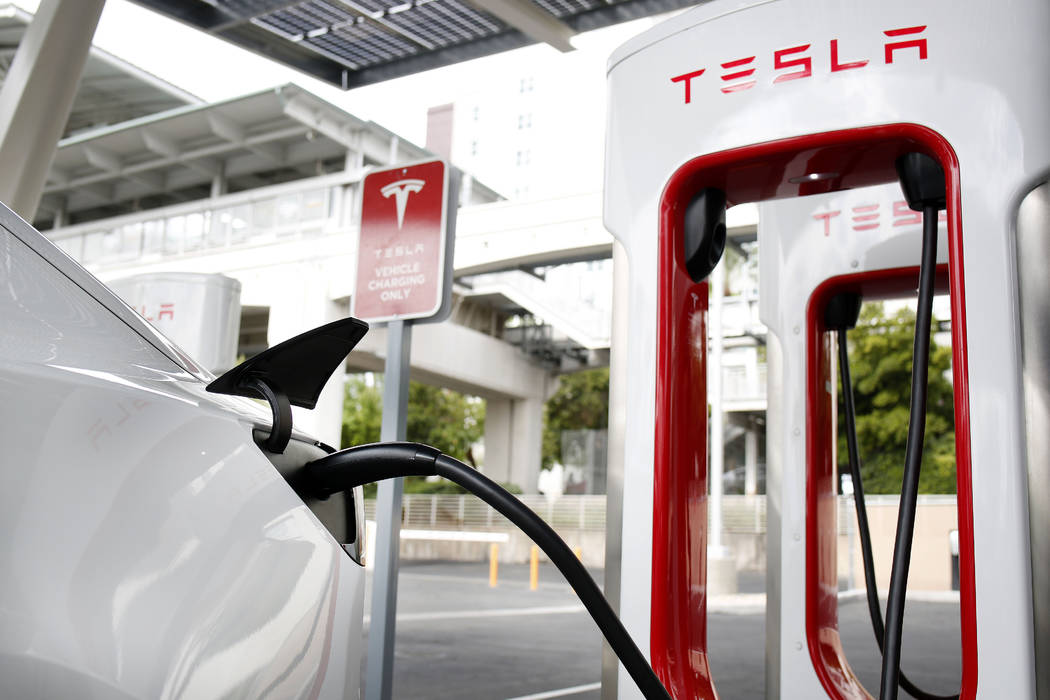 Tesla's Model 3 is charged at the largest Tesla Supercharger station now open near the High Rol ...