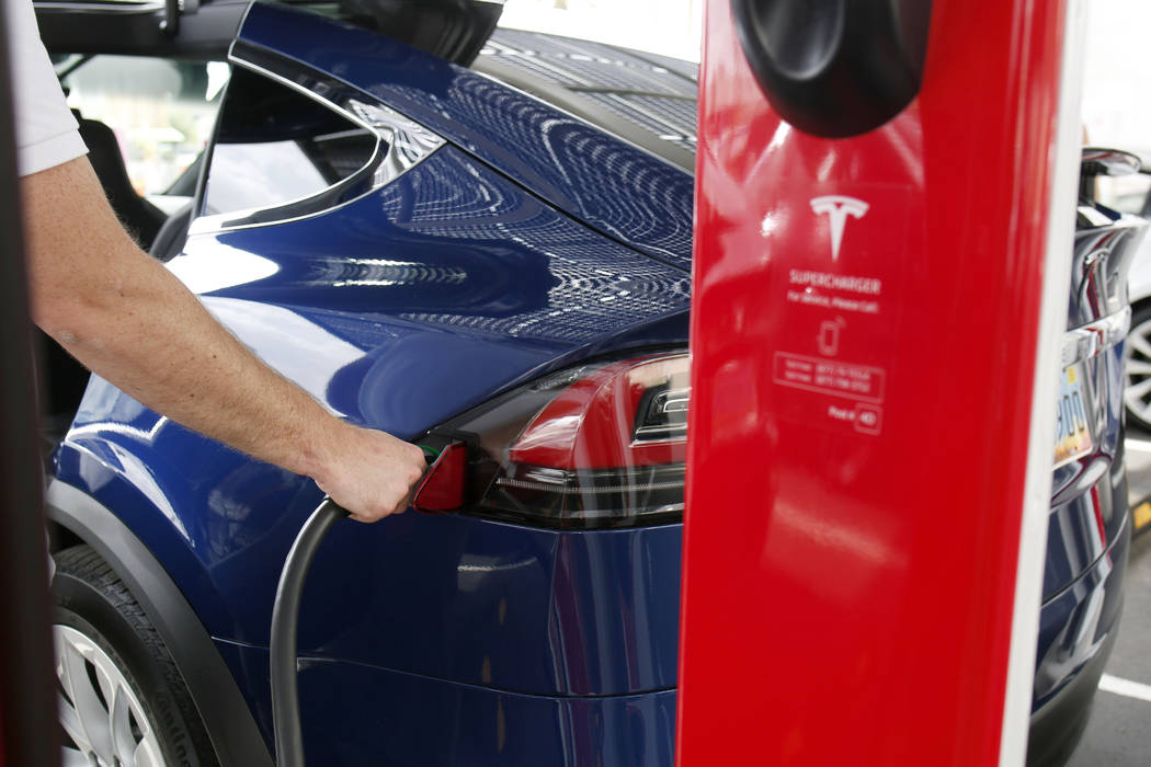 Tesla's Model X is charged at the largest Tesla Supercharger station now open near the High Rol ...