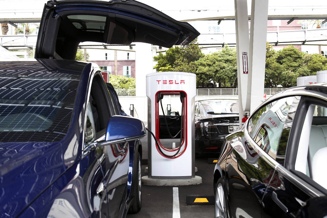 Tesla's Model X is charged by V3 Supercharger at the largest Tesla Supercharger station now ope ...