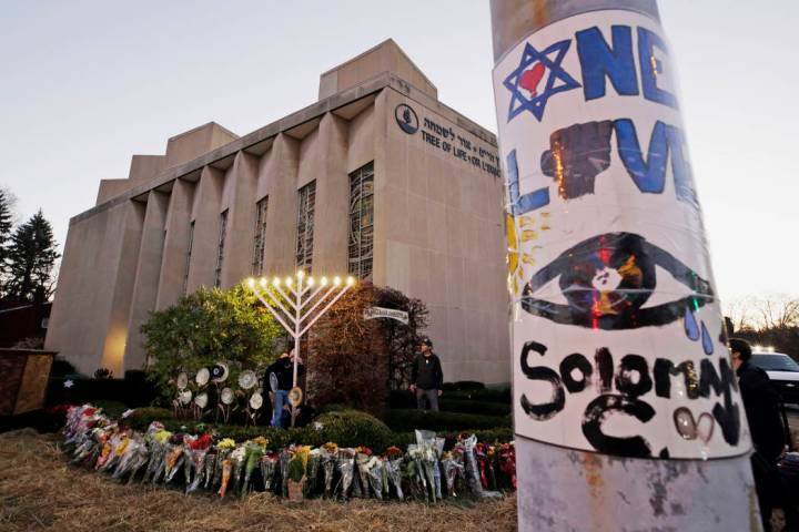 FILE - This Dec. 2, 2018, file photo shows a menorah at a memorial outside the Tree of Life Syn ...
