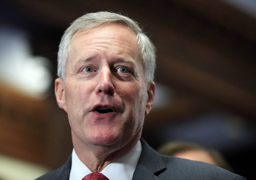Freedom Caucus Chairman Rep. Mark Meadows, R-S.C., speaks to reporters on Capitol Hill in Washi ...