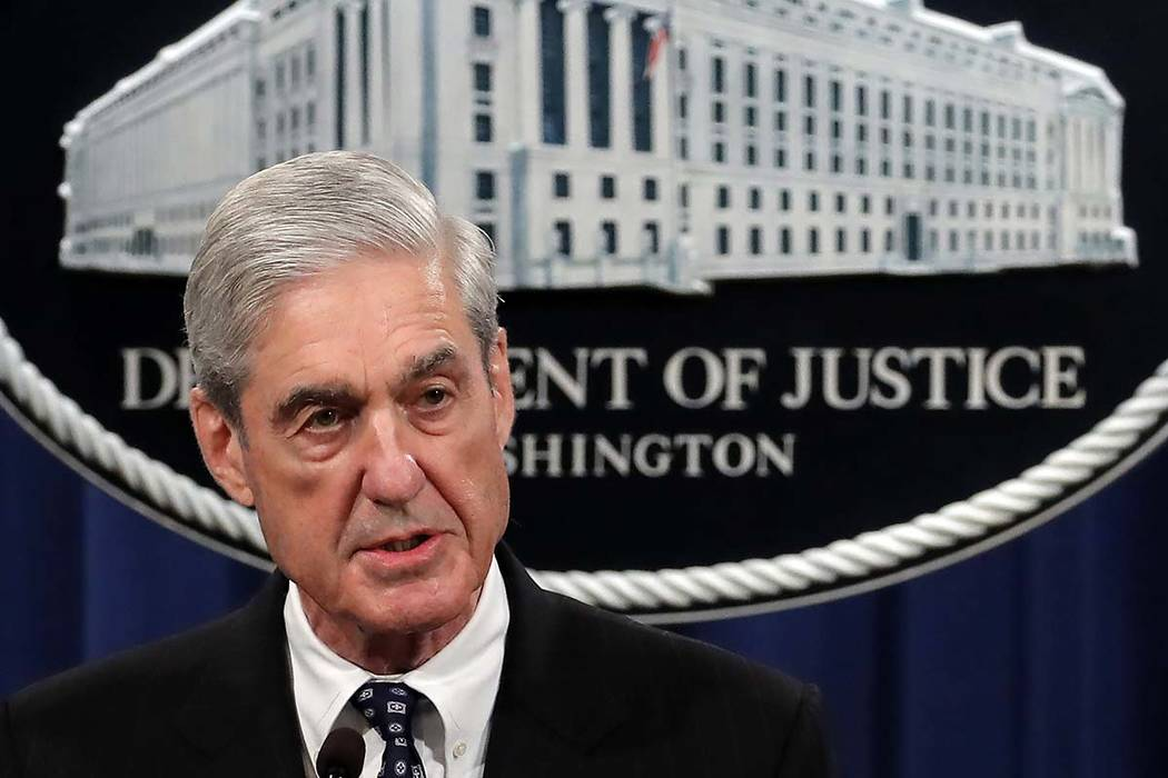 Special counsel Robert Mueller speaks at the Department of Justice Wednesday, in Washington, ab ...